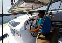 skipper in cockpit of trimaran sailing yacht neel 45