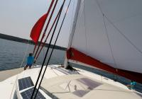 skipper on bow bowman trimaran neel 45 sails sailing deck 3