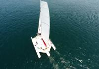 trimaran from above mast main sail flatten