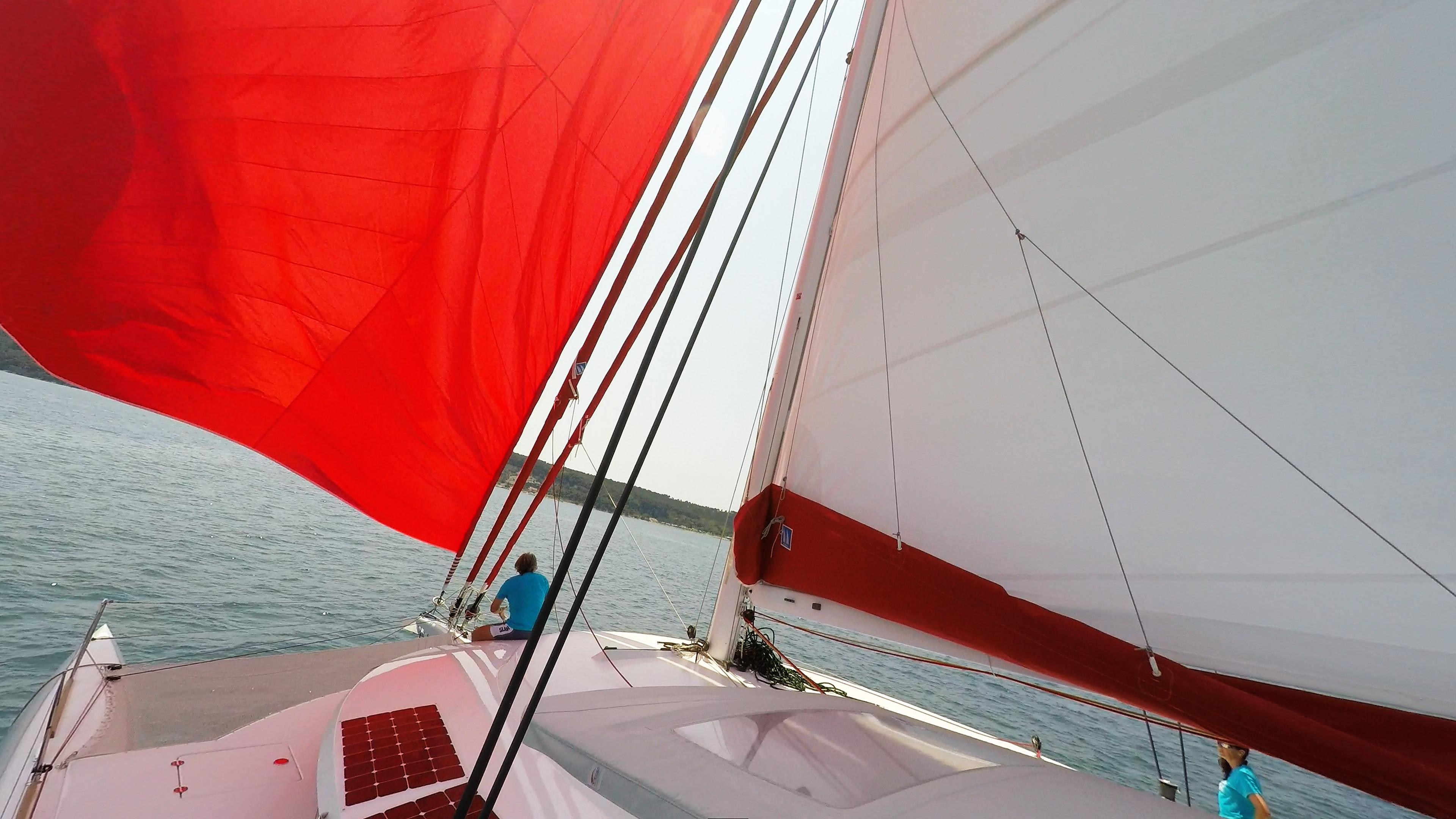 skipper on bow bowman trimaran neel 45 sails sailing deck 1