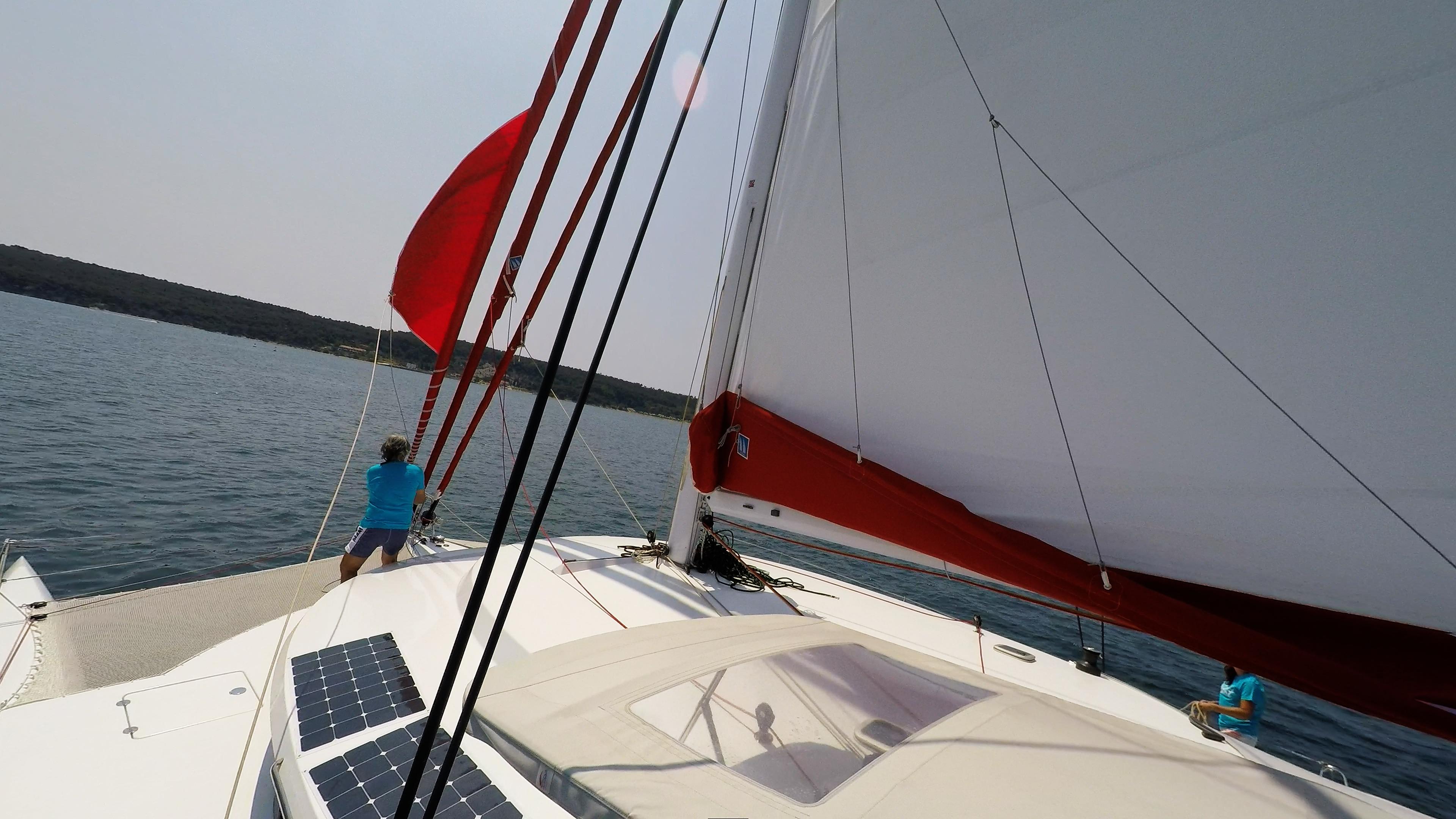 skipper on bow bowman trimaran neel 45 sails sailing deck 3