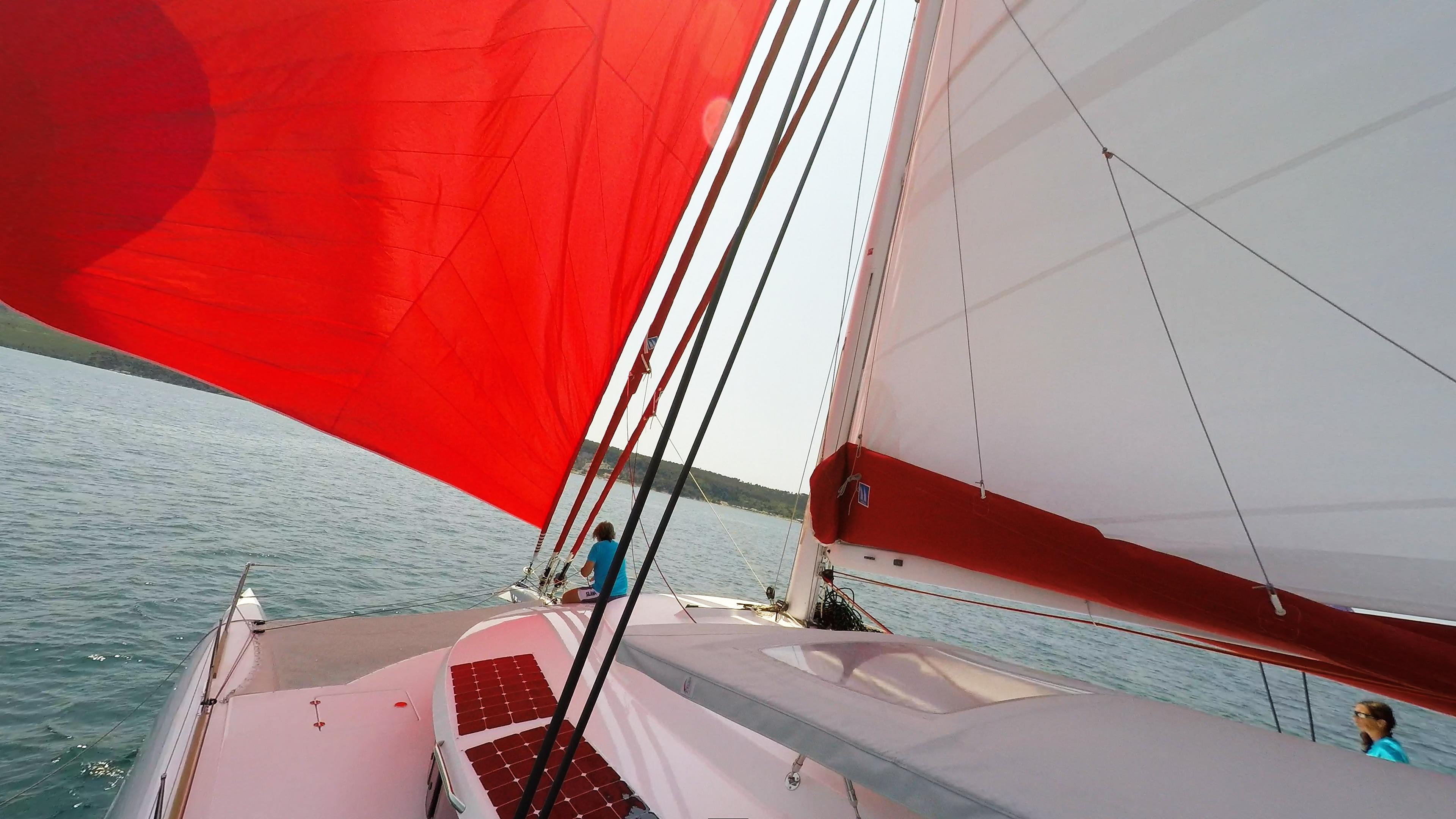 skipper on bow bowman trimaran neel 45 sails sailing deck