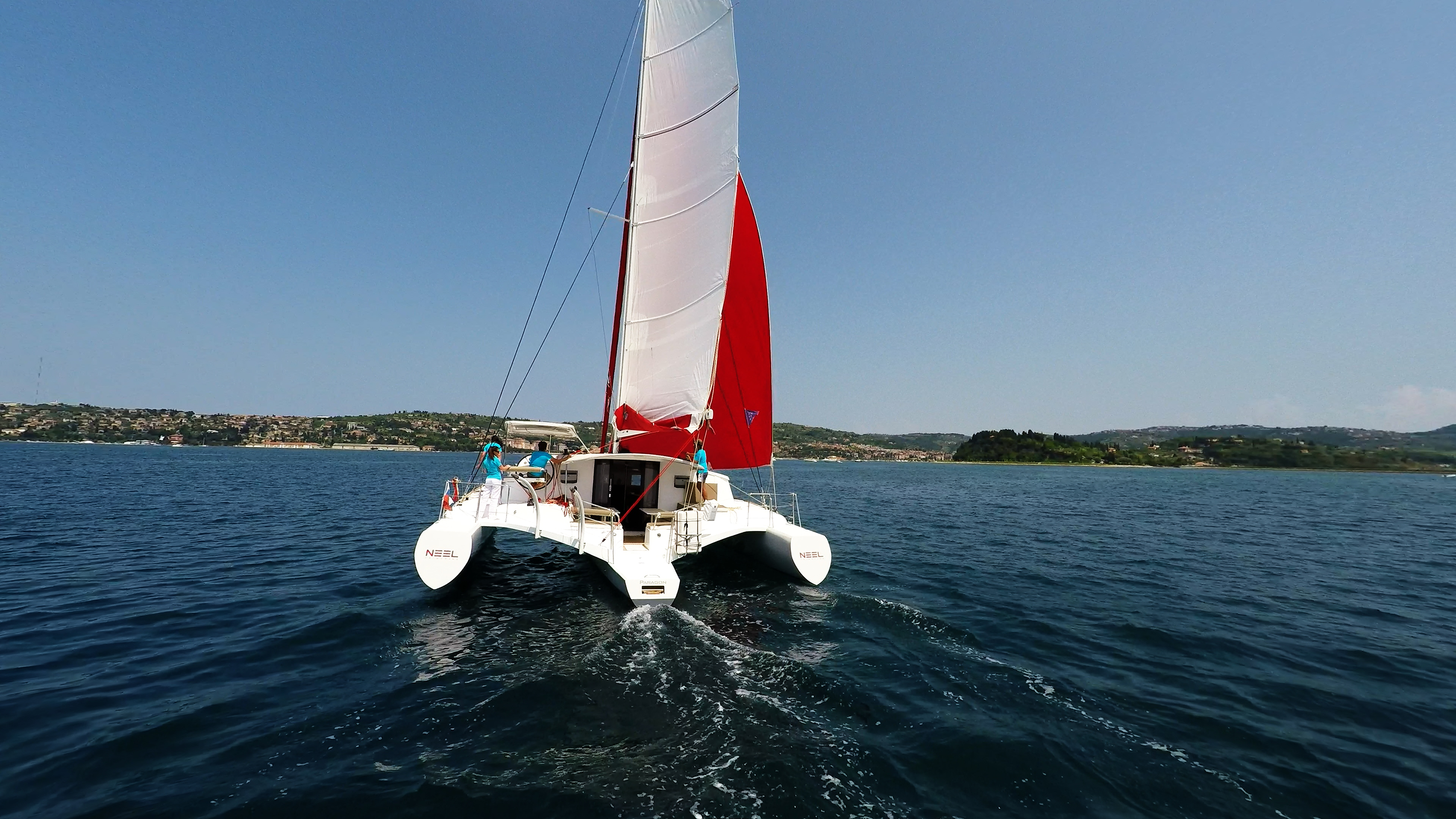 stern view multihull yacht neel 45 sailing to port