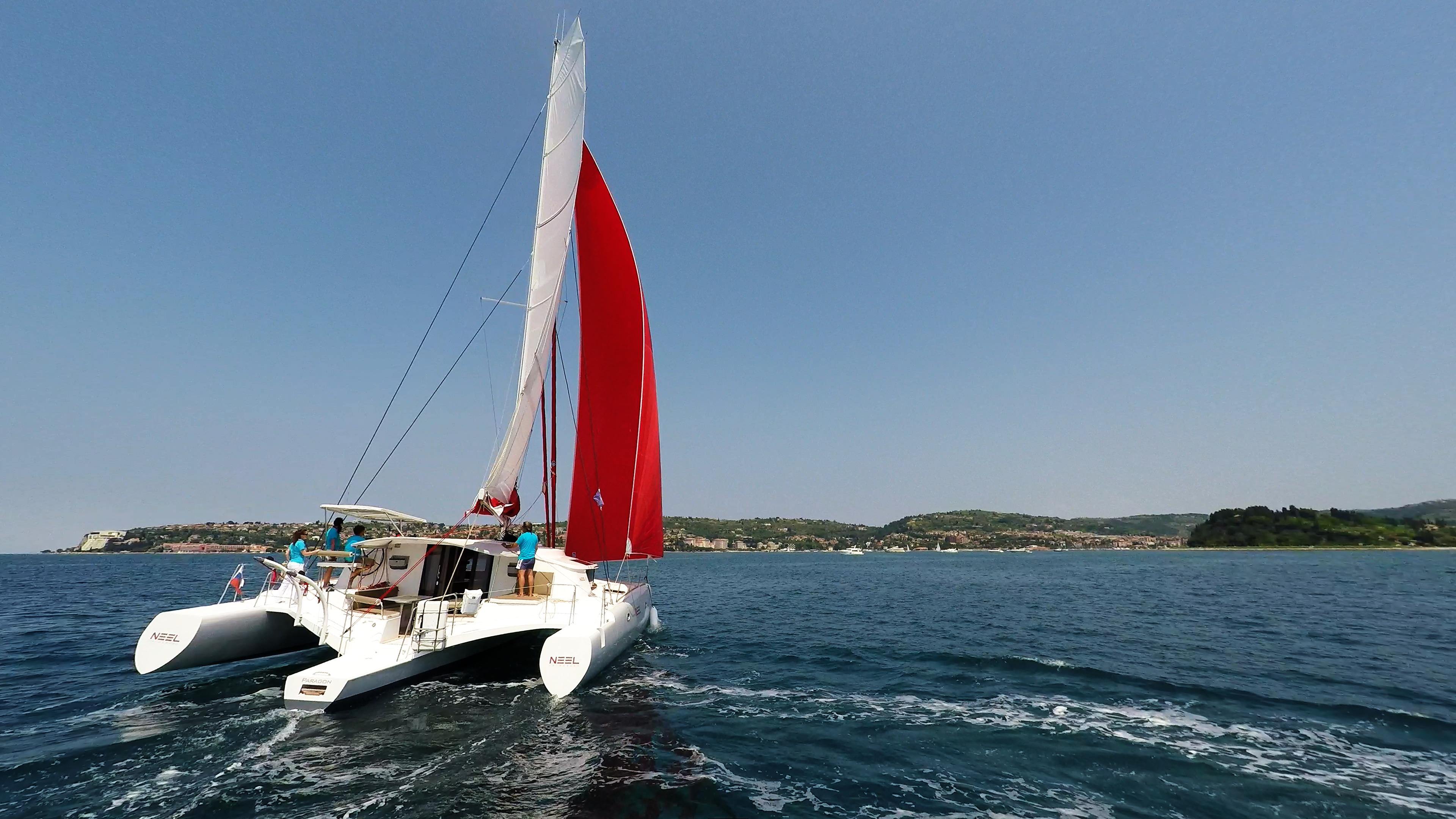 stern view of sailing multihull yacht