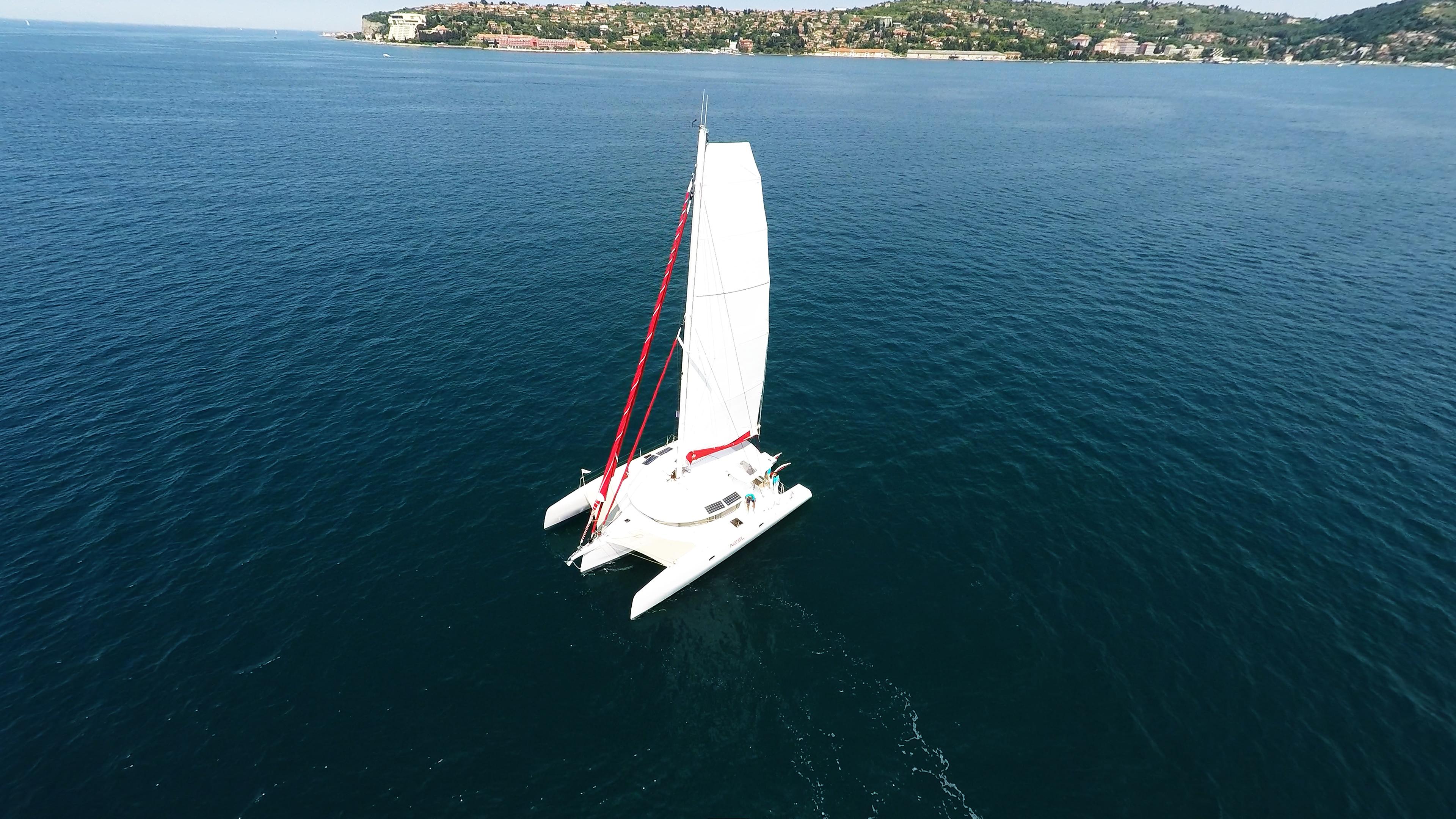 trimaran at deep blue sea sailing yacht