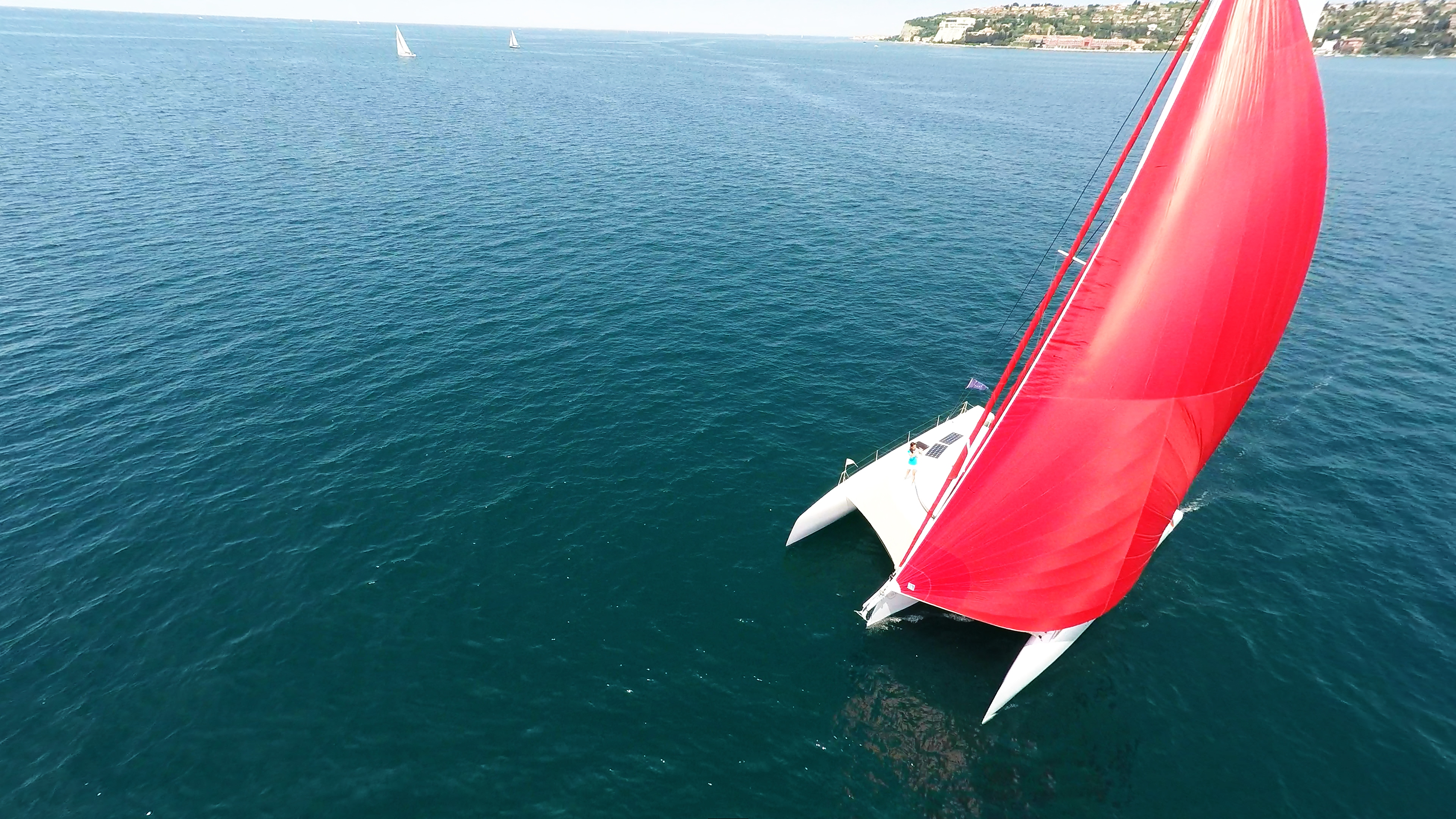 trimaran charter yacht sailing with gennaker on mast
