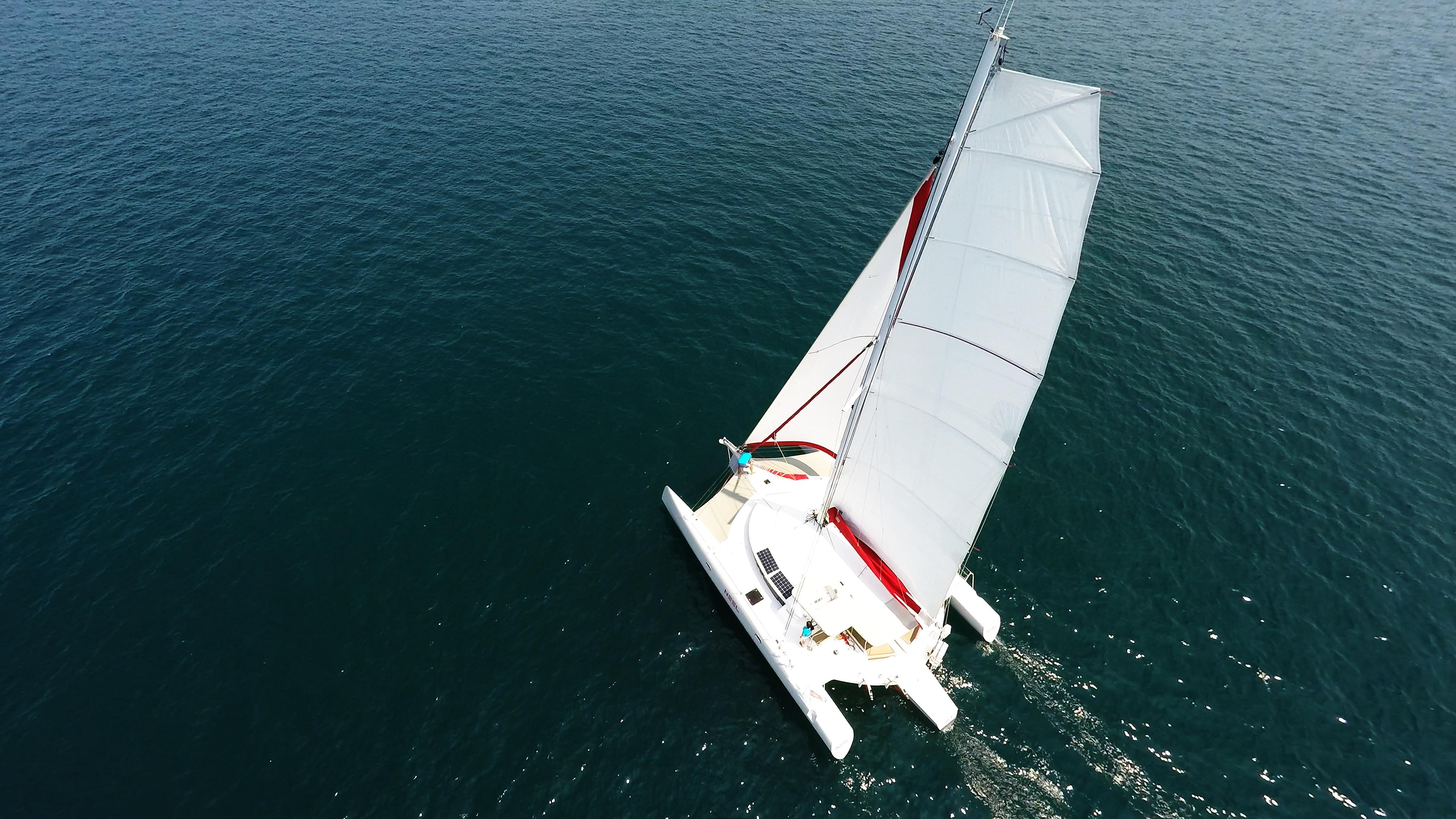 trimaran from above mast flatten main sail