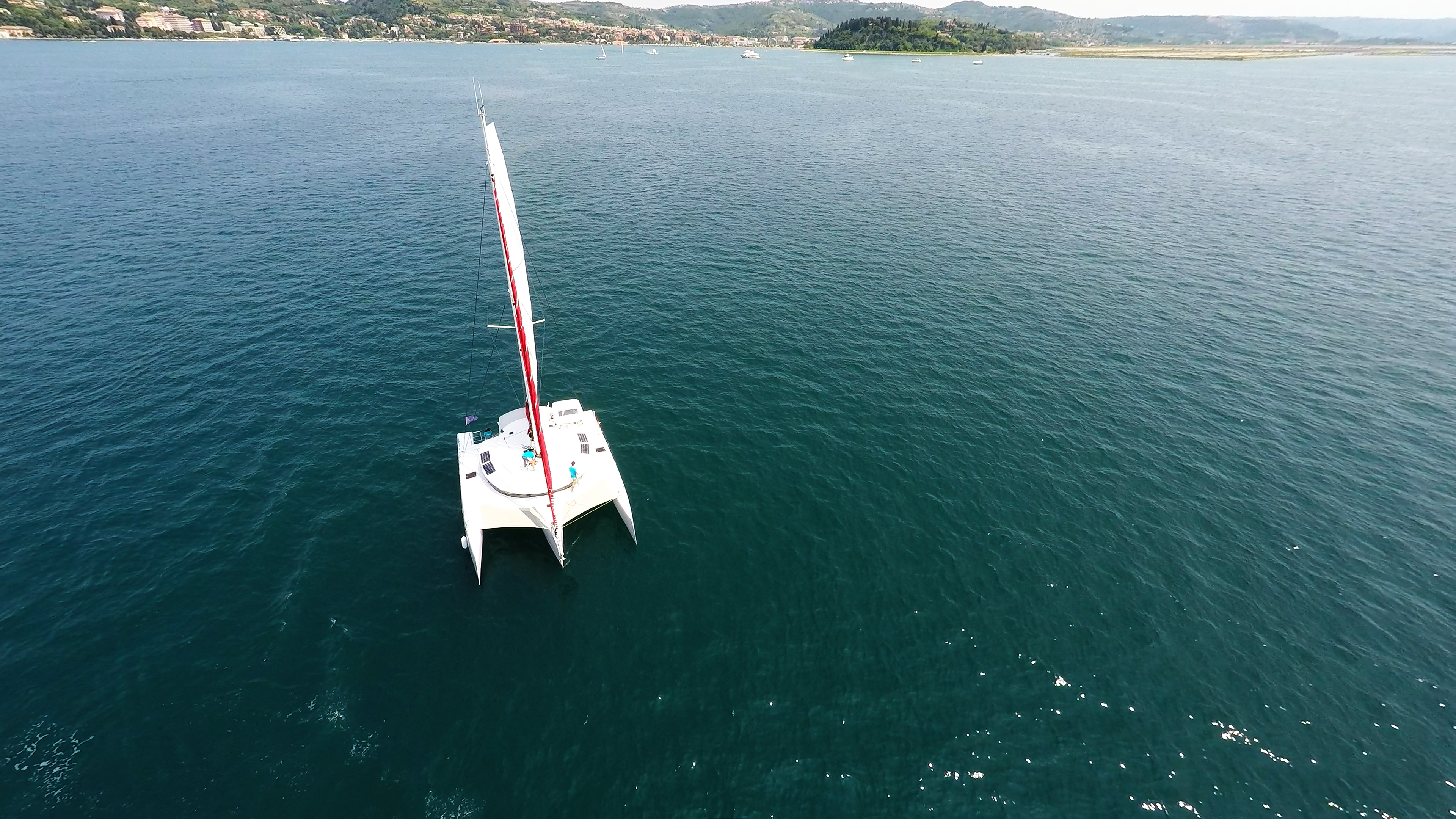 trimaran from air crew in turquoise t-shirt