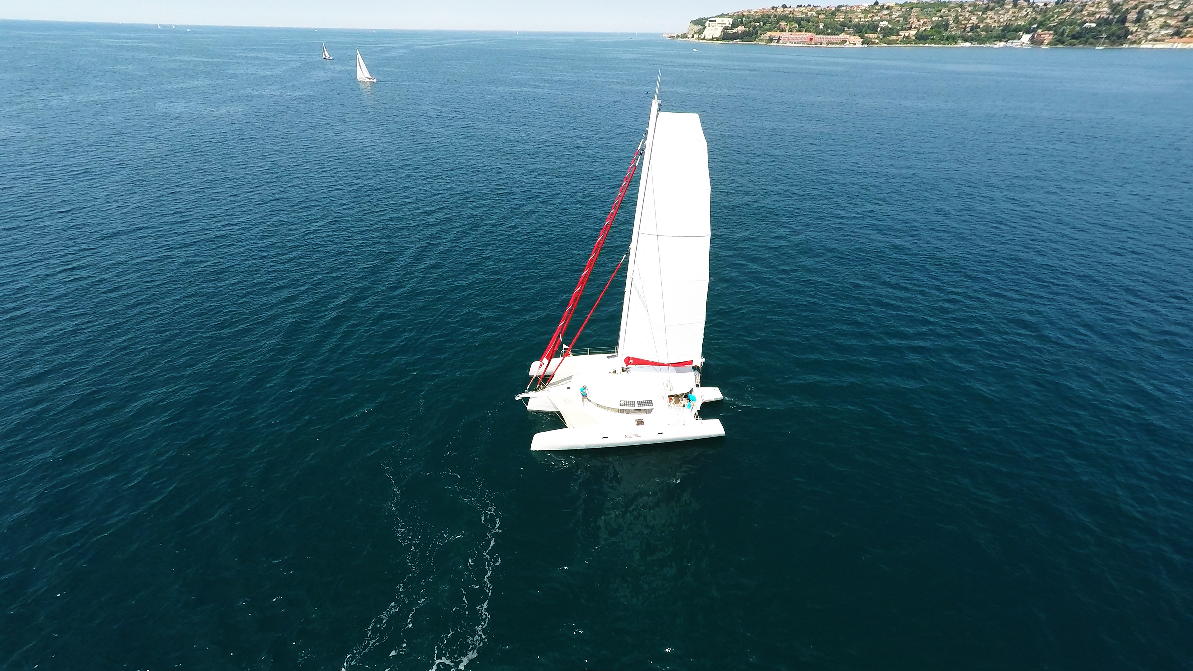 trimaran from air with crew for charter