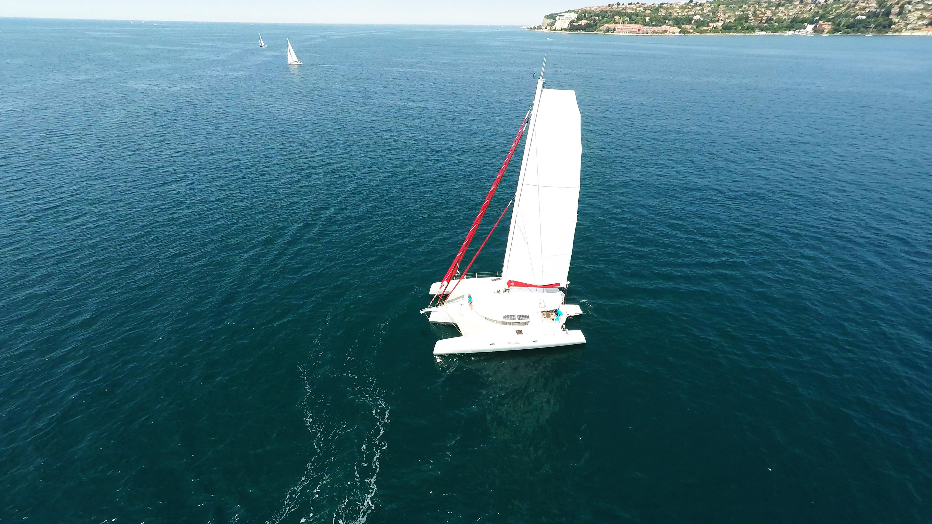 trimaran main sail at sea sailing