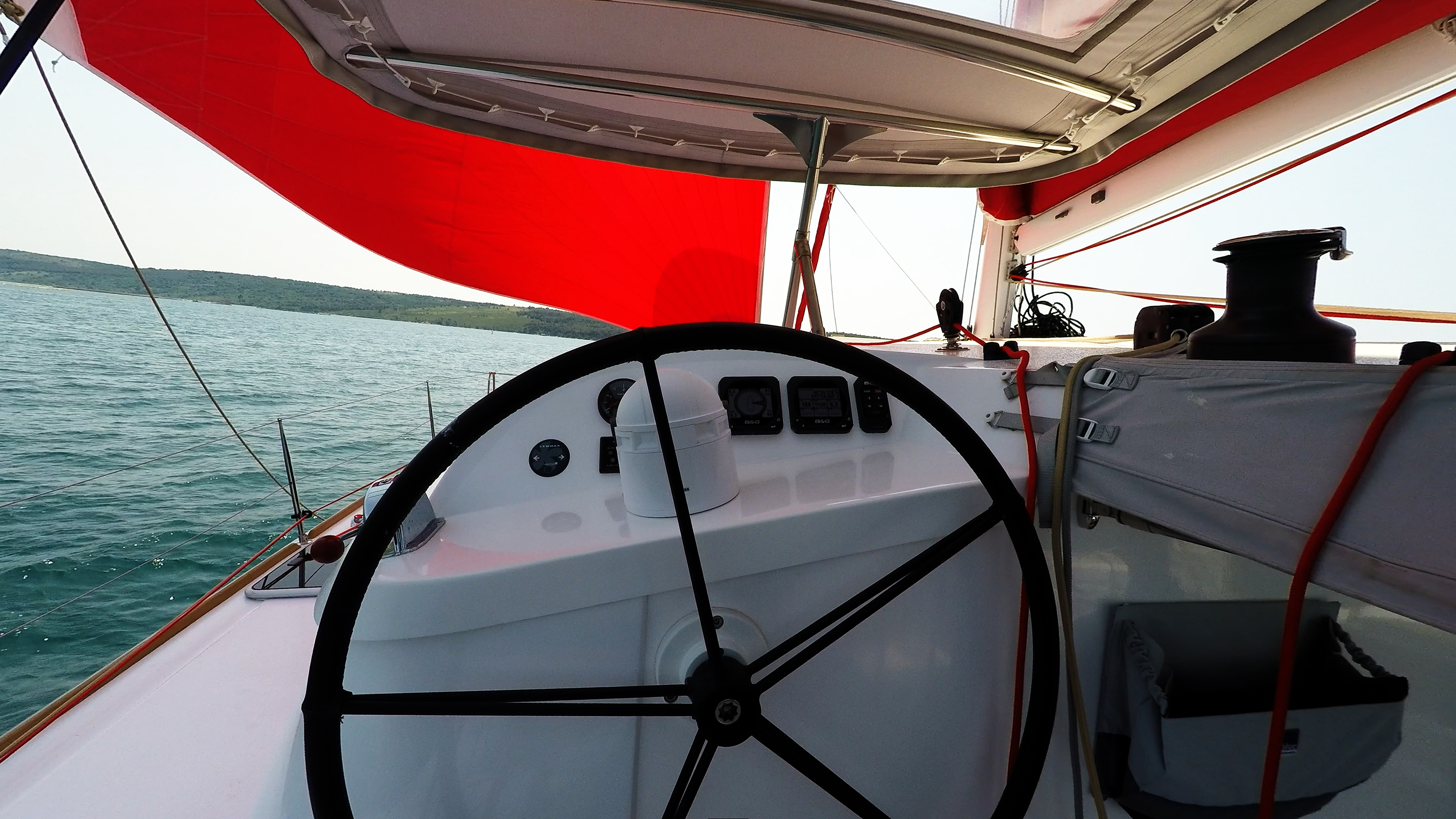 trimaran multihull sailing yacht neel 45 skipper cockpit steering wheel instruments gibb