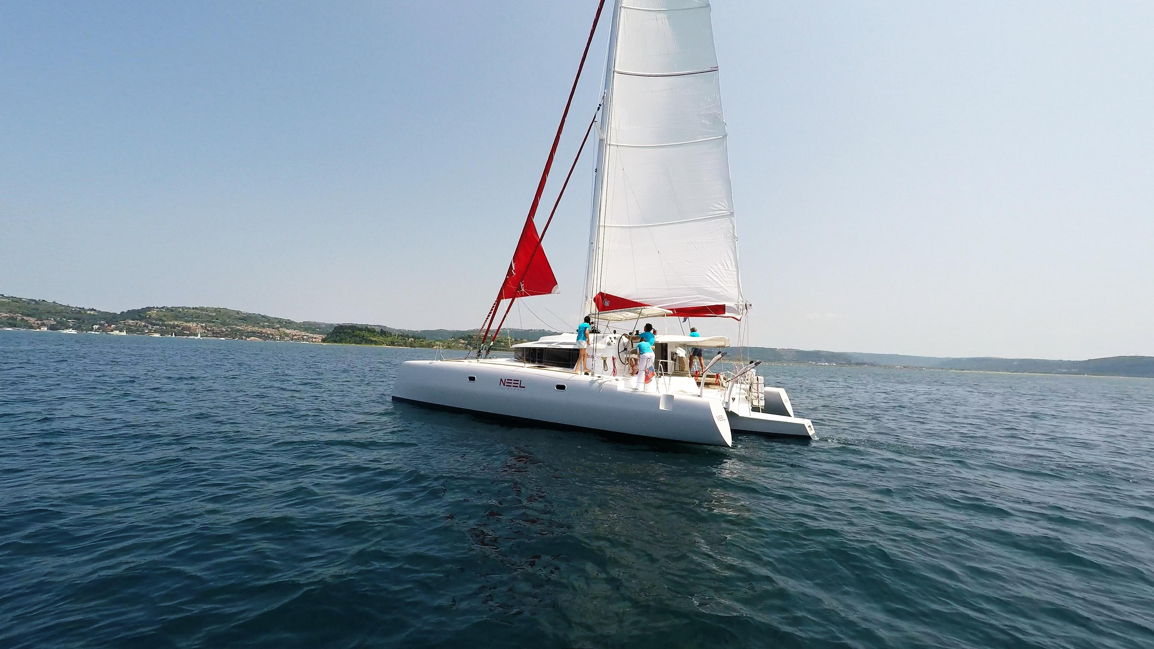 trimaran neel 45 hoisting gennaker sail
