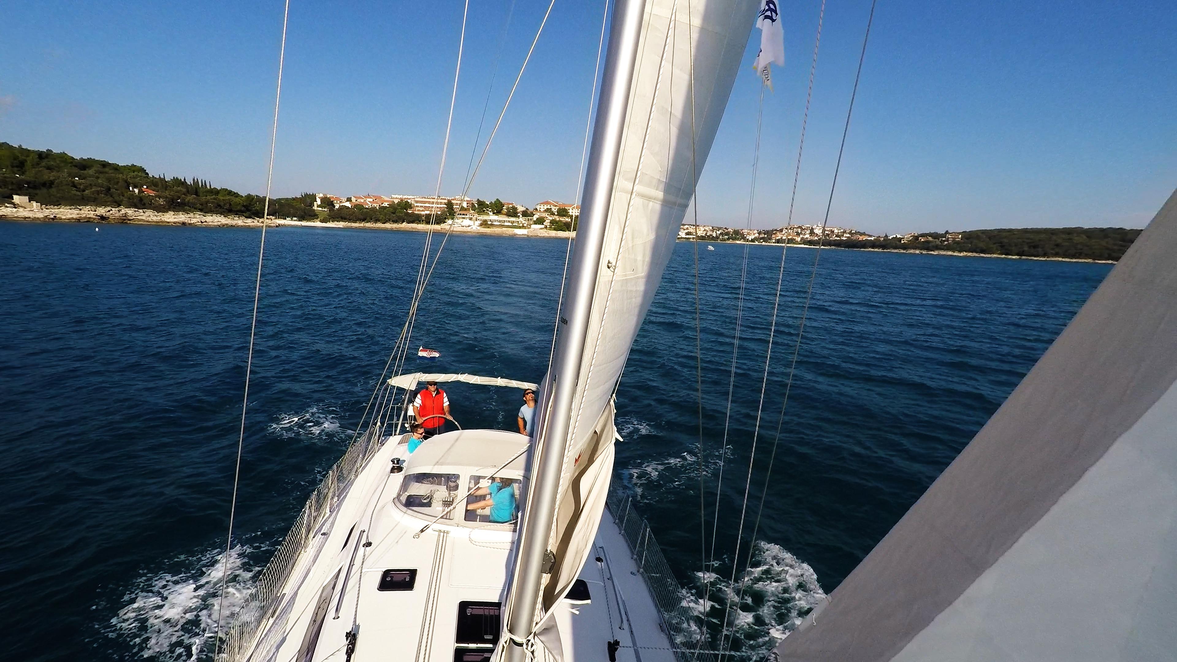 sailing yacht sailboat mast rigging shrouds sails deck