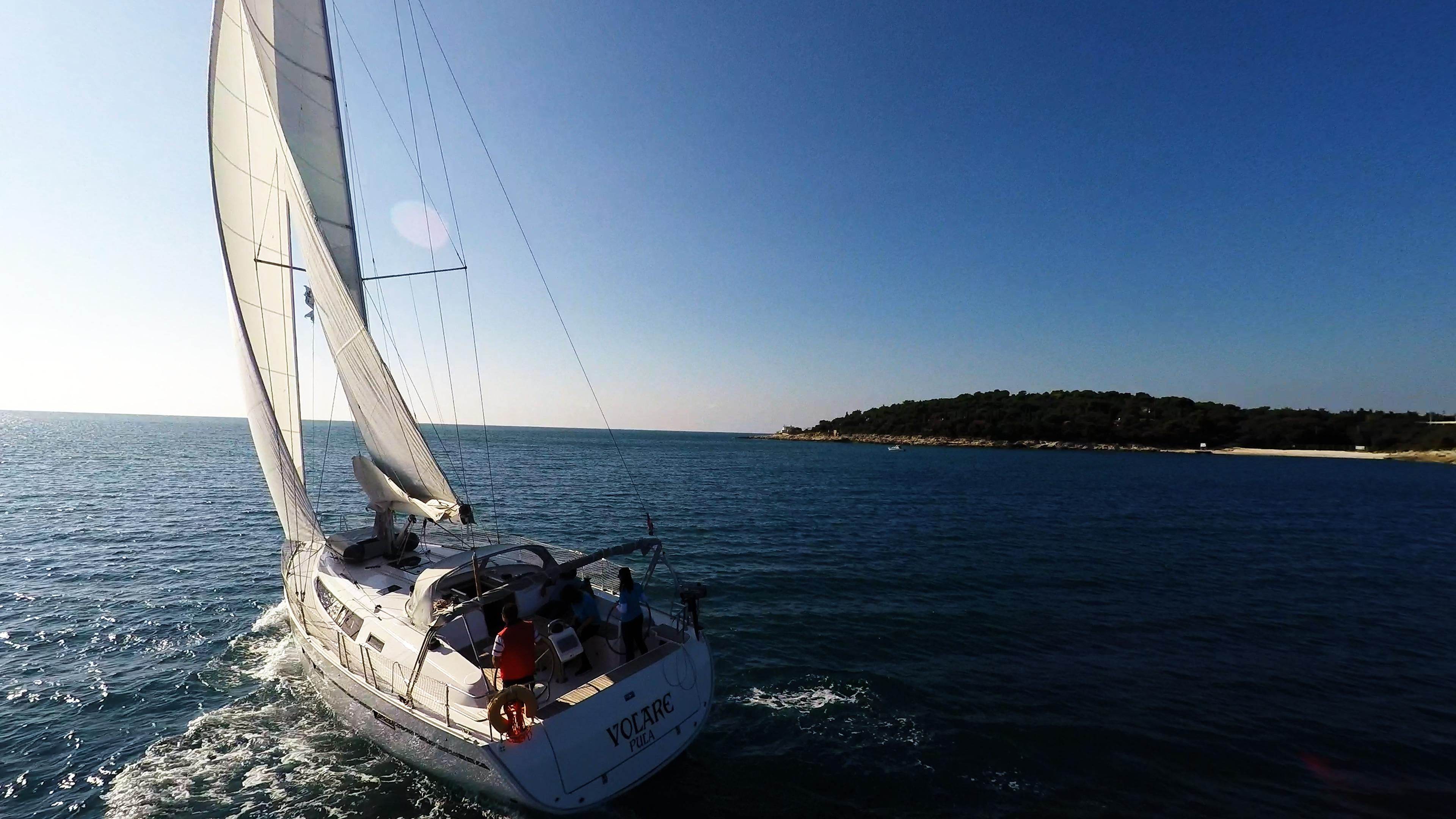 sailing yacht sails bavaria 46 cruiser sailing yacht sun blue sky