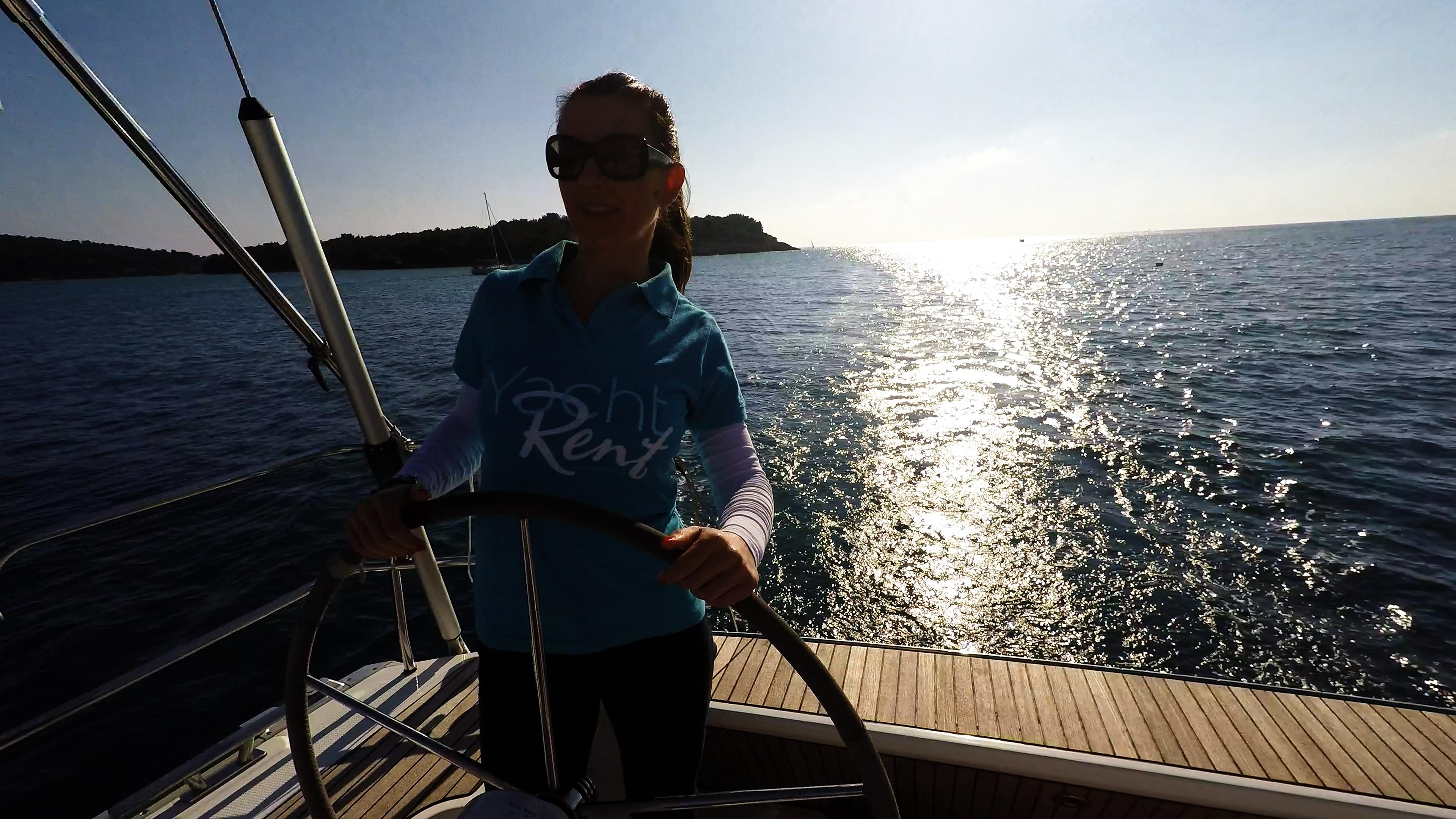 sailing yacht skipper woman steering wheel sailing yacht