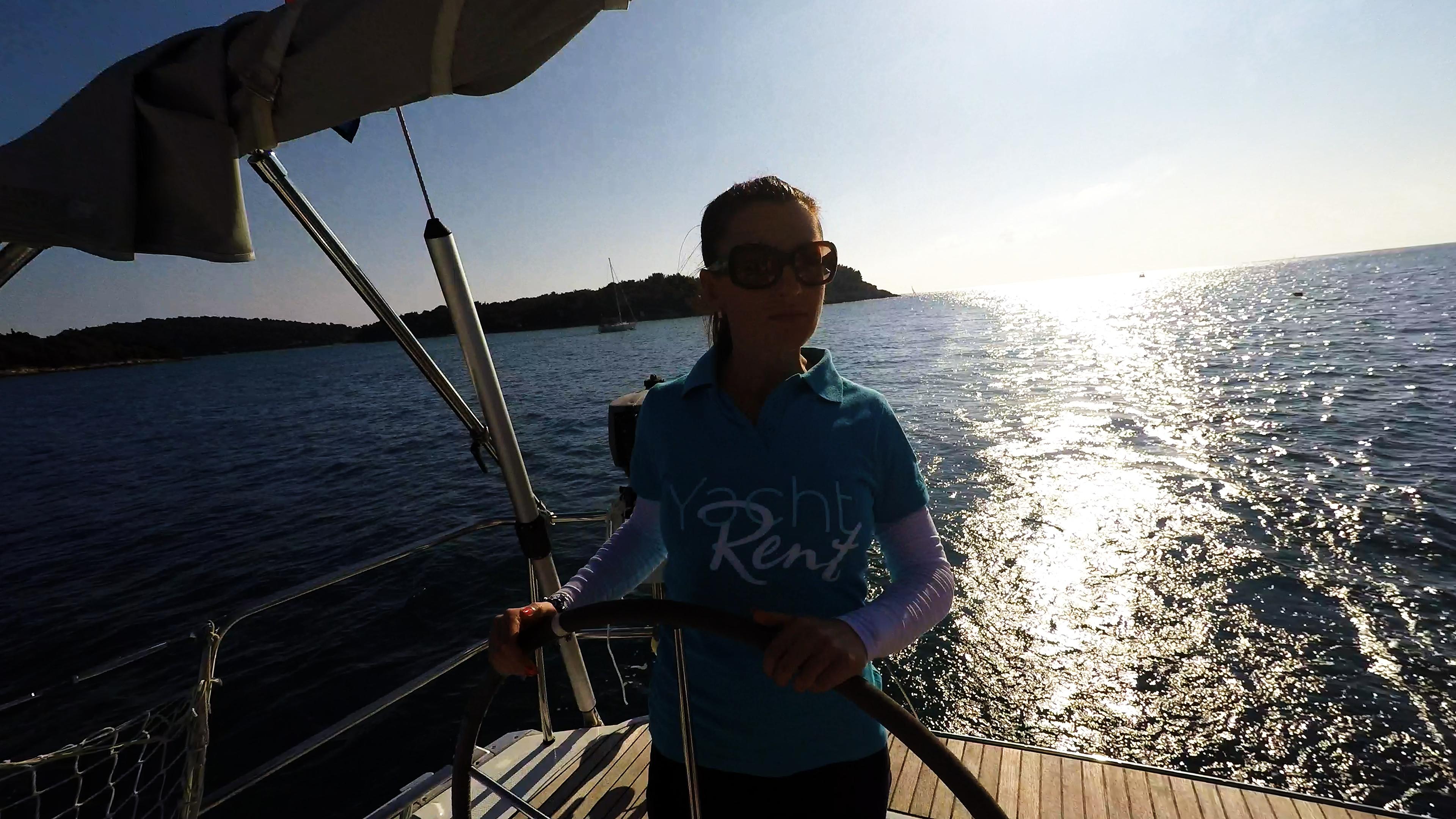 sailing yacht woman steering wheel sailboat skipper sailing yacht