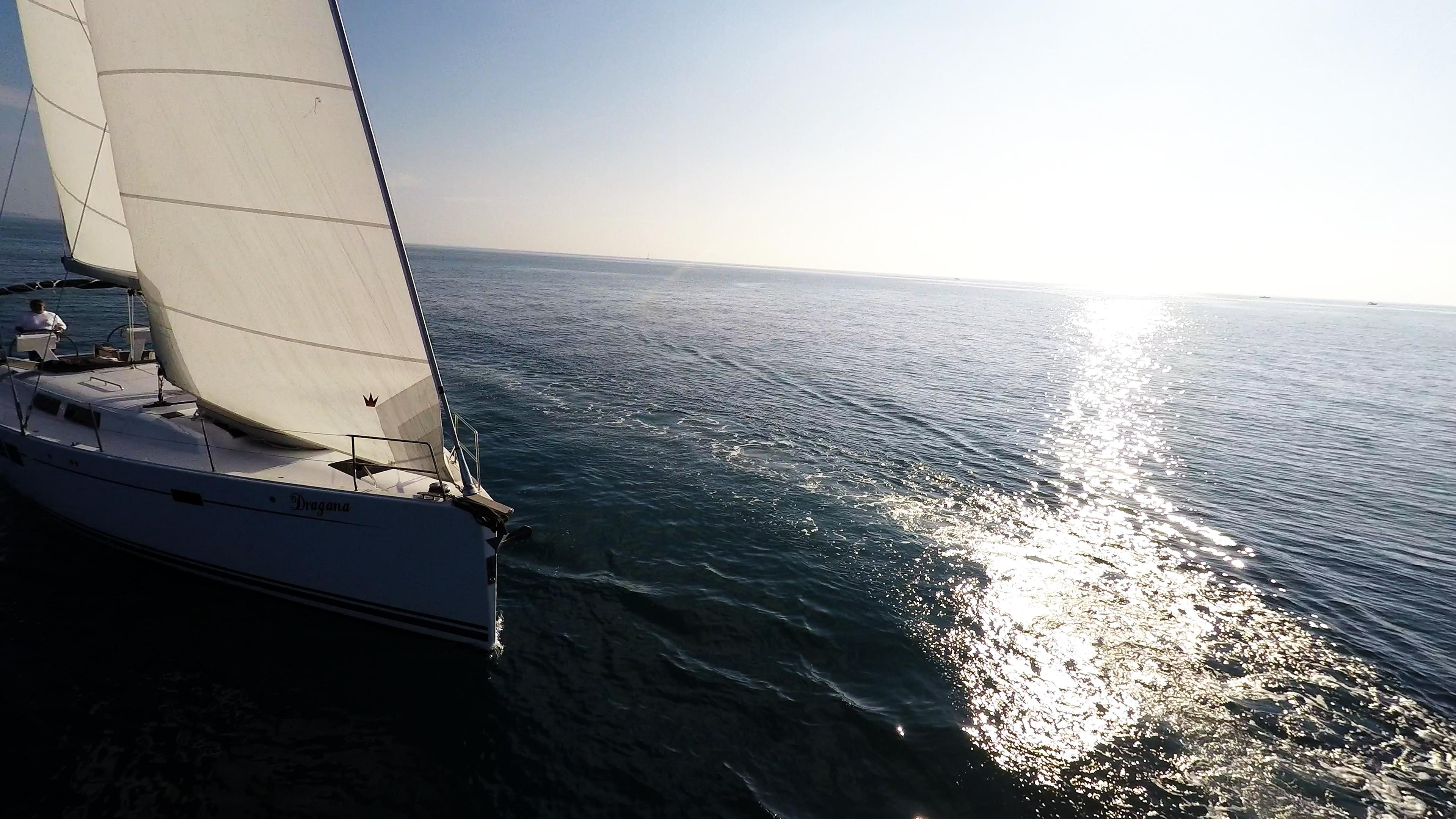 sailing yacht sails sea sunburst