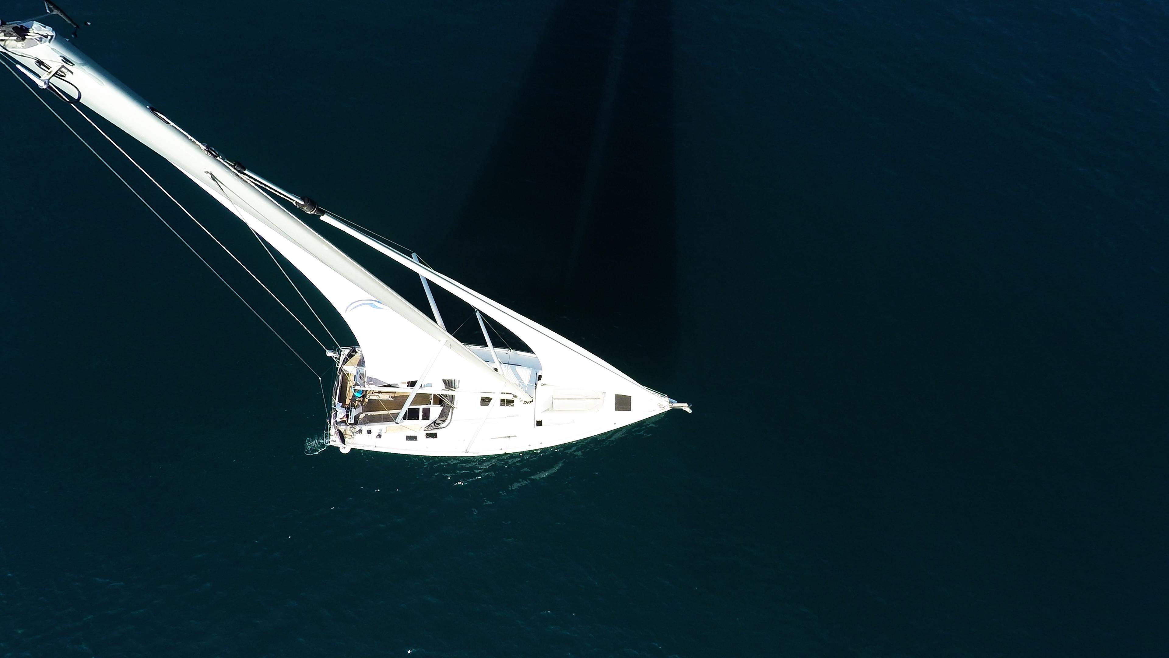 sailing yacht top mast rigging sails sailing yacht sea blue