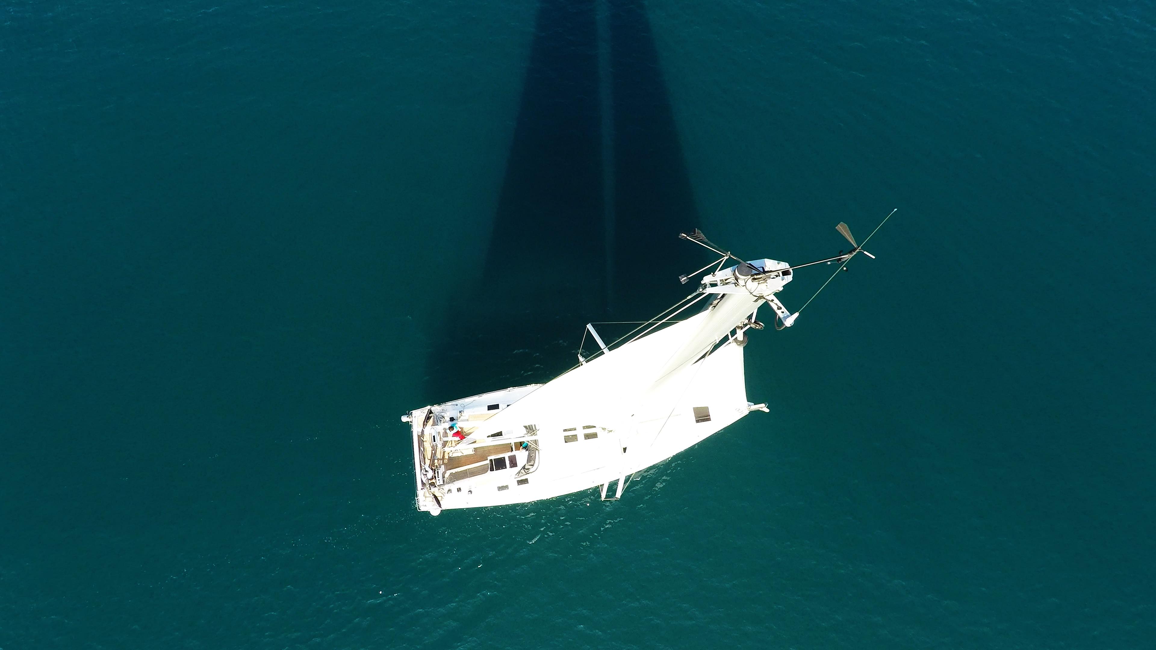 sailing yacht top mast sails main sail rigging sailboat deck sea